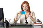 Woman banker holds a credit card — Stock Photo