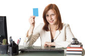Manager female holding a credit card — Stock Photo