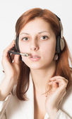 Girl operator of technical support service — Stock Photo