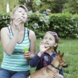 Mother and daughter blow soap bubbles — Stock Video #26383627