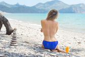 Girl sunbathe on the beach — Stock Photo