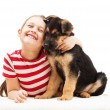 Cheerful child tenderly hugging a puppy — Stock Photo #44496701