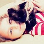 Little girl hugging a cat — Stock Photo #44497869