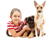 Little girl and her four-legged friends — Stock Photo