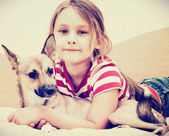 Girl and red puppy  — Stock Photo