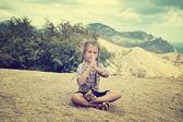 Little girl meditates — Stock Photo