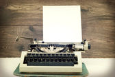 Typewriter on wooden background — Stock fotografie