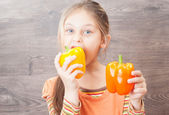 Little girl eating vegetables — Stock Photo