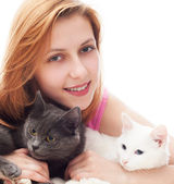 Beautiful smiling girl hugging her two cats — Stock Photo