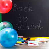 Back to school - inscription on blackboard — Stock Photo