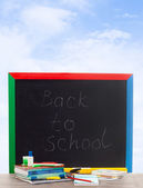 School board on a background of blue sky with clouds — Stock Photo