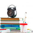 Books and an alarm clock on a wooden table on a white background — Stock Photo #49950905
