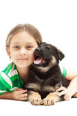 Child hugging a puppy German Shepherd — Stock Photo