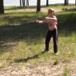 Stock Video: Girl playing outdoors flying disc