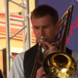 Stock Video: Trumpeter playing in street