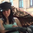 Stock Video: Girl in old carriage