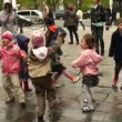 Children dancing in the street — Stockvideo