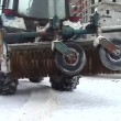 Brush on tractor for cleaning streets — Stock Video #18008237