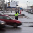 Stock Video: Policemcontrols traffic at crossroads