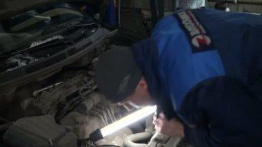 Mechanics Looking at Car — Stock Video