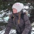 Stock Video: Girl under tree in winter forest