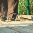 Mens feet in Slippers on the street — Stock Video #28034185