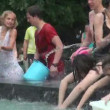 A crowd of people drenched in water — Stock Video