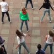 Stock Video: Group of girls dancing in square