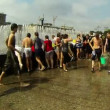 Stock Video: Crowd of people drenched in water
