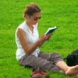 Girl with a book on the grass — Stock Video