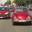 Stock Video: Driver and vehicle beetle