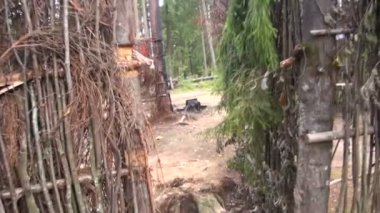 Military camp in the woods — Stockvideo