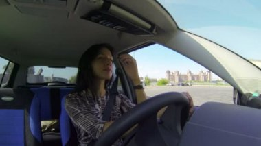 Brunette driving the car — Stock Video