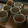 Stock Video: Iron mugs with compote