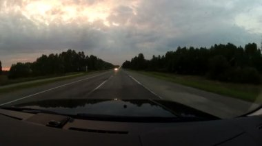 Travel on the highway at sunset — Stockvideo