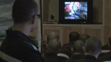 Prisoners watching TV — Stock Video
