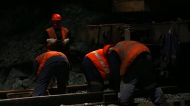 Railway workers bolting track rail to ballast — Stock Video