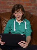 Teenager looking at tablet computer — Stock Photo