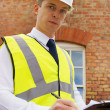 Construction professional with clipboard, an inspector, surveyor - Stock Photo