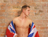 Buff young guy with Union Jack UK or GB flag — Stock Photo