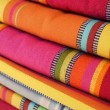 Stock Photo: Brightly colored textiles in market