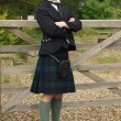 Stock Photo: Handsome young Scotsman in a kilt
