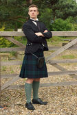 Handsome young Scotsman in a kilt — Stock Photo