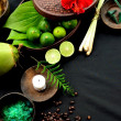 Tropical Asian spa supplies on black background - Stock Photo