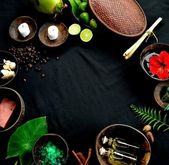 Tropical Asian spa supplies on black background — Stok fotoğraf