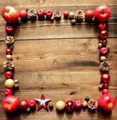 Frame of Christmas ornament and red apples — Stock Photo