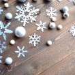 Paper cutout of snowflakes on wood background — Lizenzfreies Foto