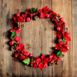 Red poinsettia Xmas wreath — Stock Photo