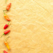 Red peppers on craft paper — Stock Photo #17450883