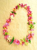 Lei of tropical flowers — Stock Photo